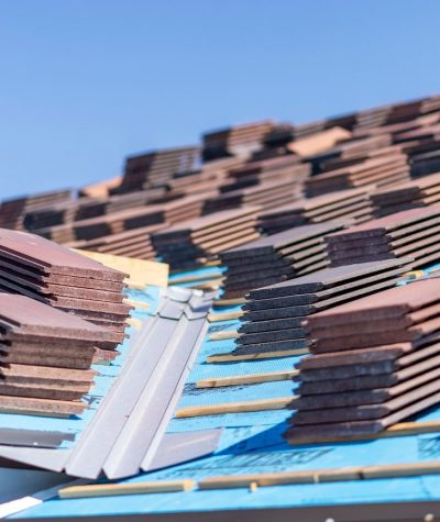 Flat Tiles Stacked on the Roof by Heritage Roofing 4