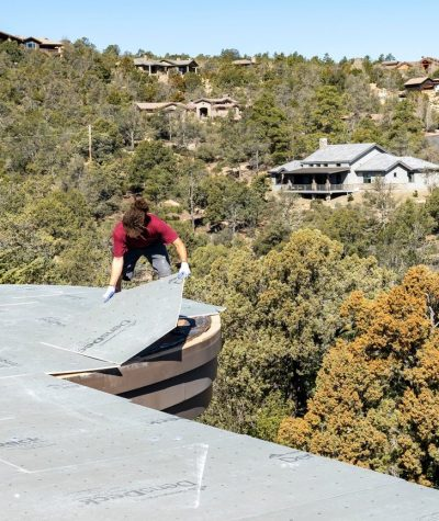 Heritage Roofing Contractor Employee Preparing A Flat Roof in Prescott, AZ