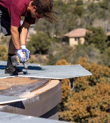 Heritage Roofing Contractor Screwing Down Prime Roof Board in Prescott, AZ