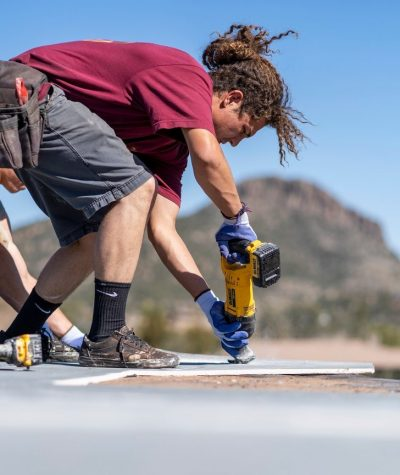 Heritage Roofing Contractor Employee Securing Prime Roof Board In Prescott, AZ