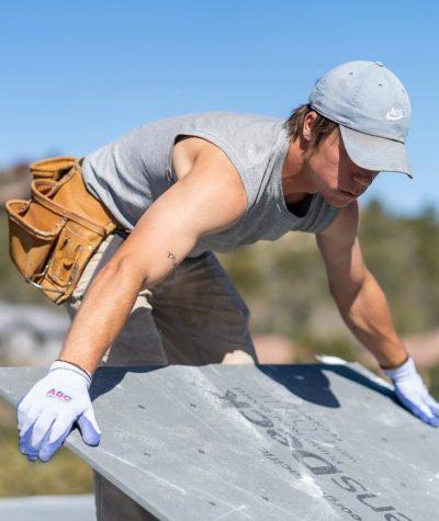 Heritage Roofing Service Employee Installing Prime Roof Board in Prescott, AZ