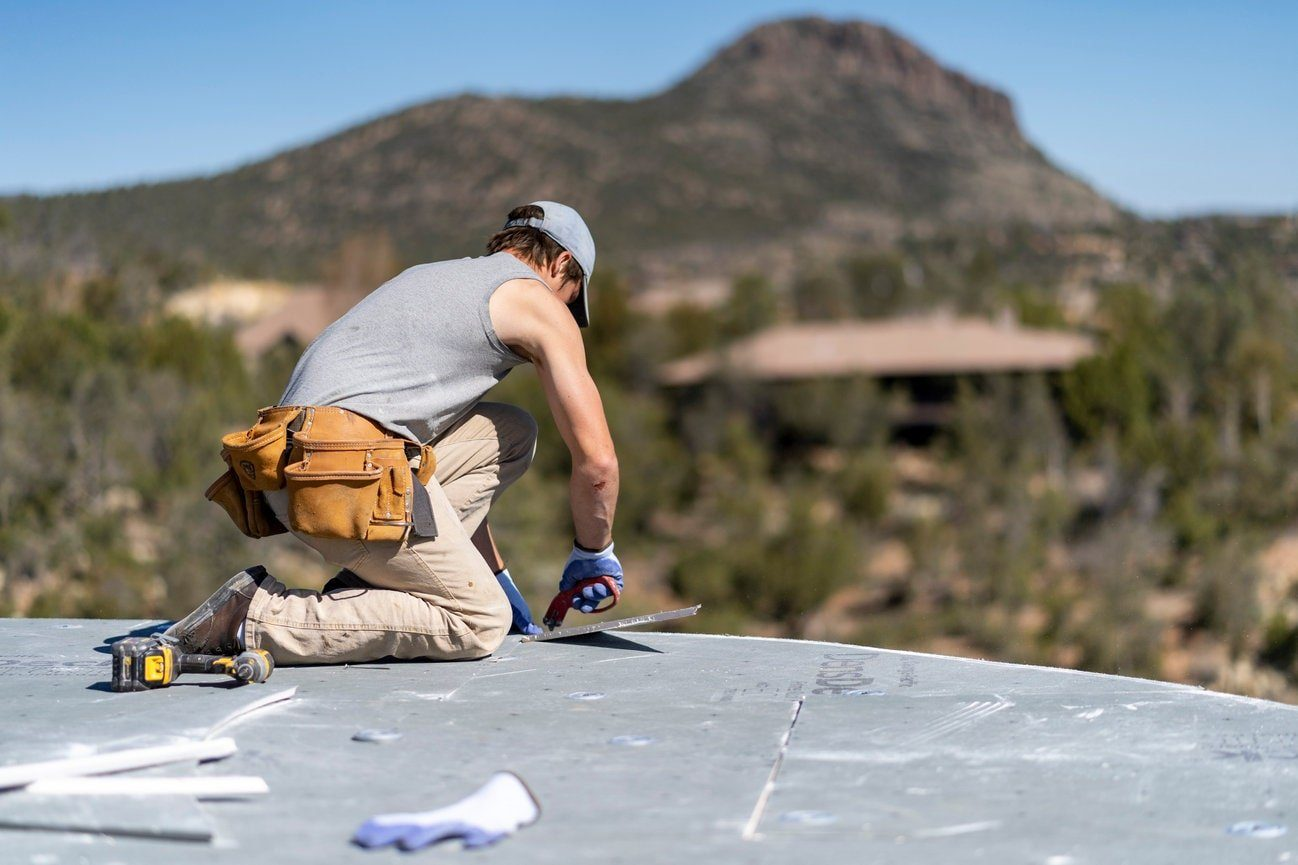 Employee of Heritage Roofing Company Using Gloves While Working On A Roof in Prescott, AZ