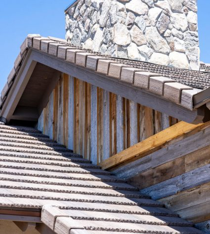 Close Up Of A Chimney on a Flat Tile with Standing Seam Metal on a Newly Constructed Residential Roof by Heritage Roofing in Prescott, AZ