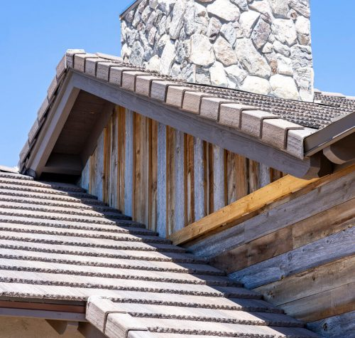 Close Up Of A Chimney on a Flat Tile with Standing Seam Metal on a Newly Constructed Home by Heritage Roofing in Prescott, AZ